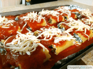 roll ups topped with more sauce and shredded mozzarella cheese