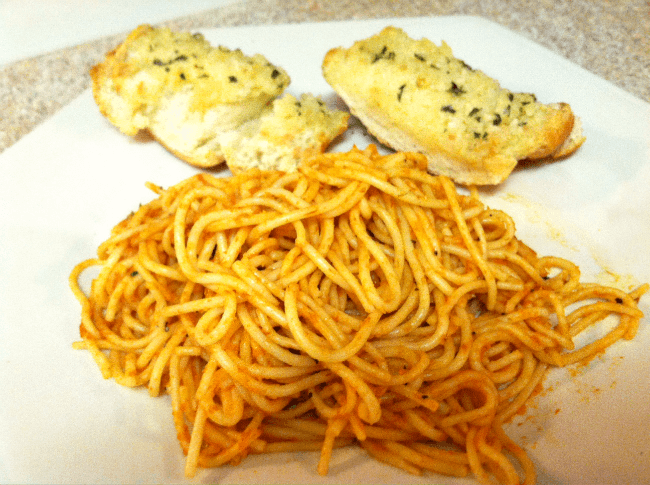 Plate of spaghetti and garlic bread