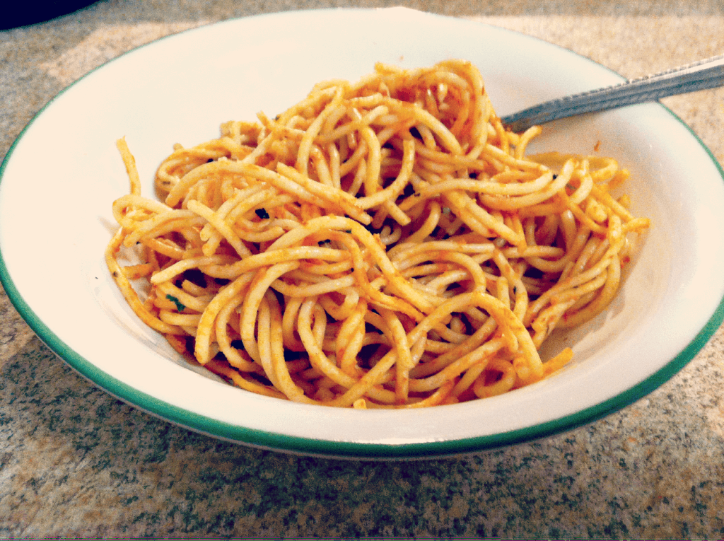 white bowl with spaghetti and a fork