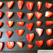 Strawberry Slices on a sheet pan and ready for the oven