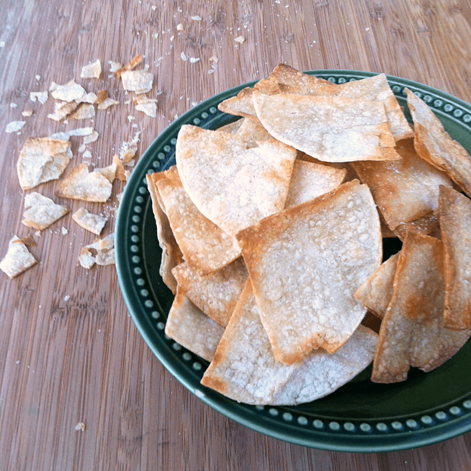 Homemade tortilla chips - only 159 calories per serving and ready in under 20 minutes. Cost of whole recipe is just $0.71! | www.savorandsavvy.com