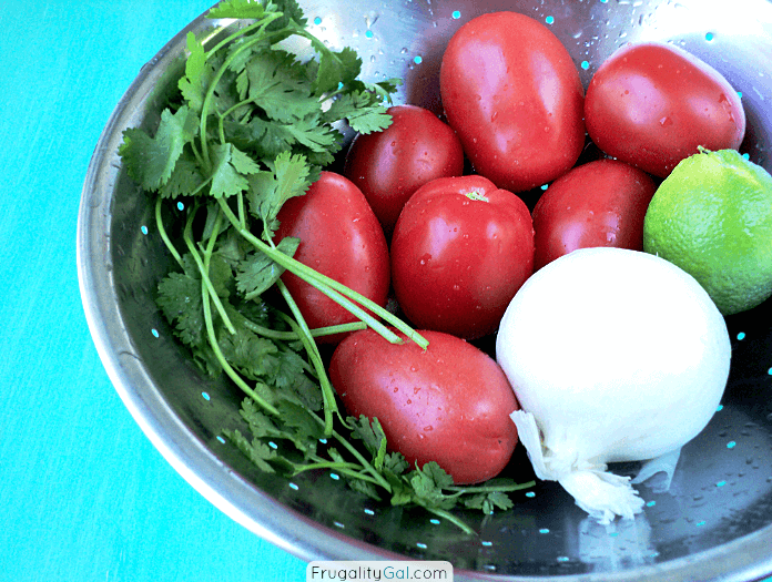 Bowl of Fresh tomatoes, onion, lime and cilantro. Mild, fresh, tangy and delicious.