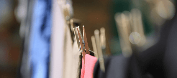 clothes line with pins holding clothes for drying