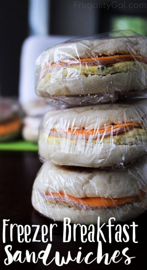 stack of homemade breakfast sandwiches ready for the freezer and wrapped