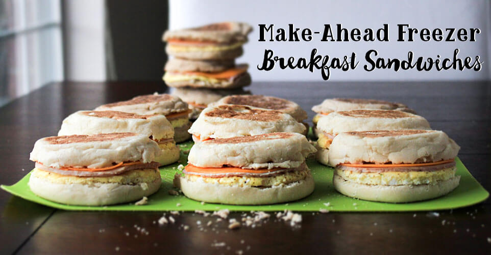 homemade breakfast sandwiches on a green cloth napkin