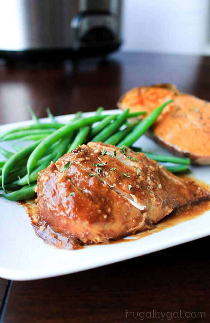 Slow Cooker BBQ Chicken and sweet potatoes with green beans on a white plate.