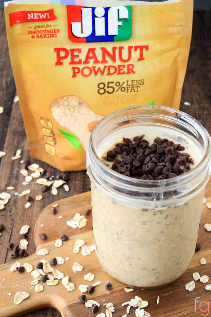overnight oats in a jar with peanut powder in the bag behind it.