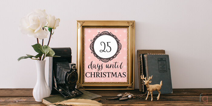 peach background on a Christmas Countdown inside a picture frame on a mantel.