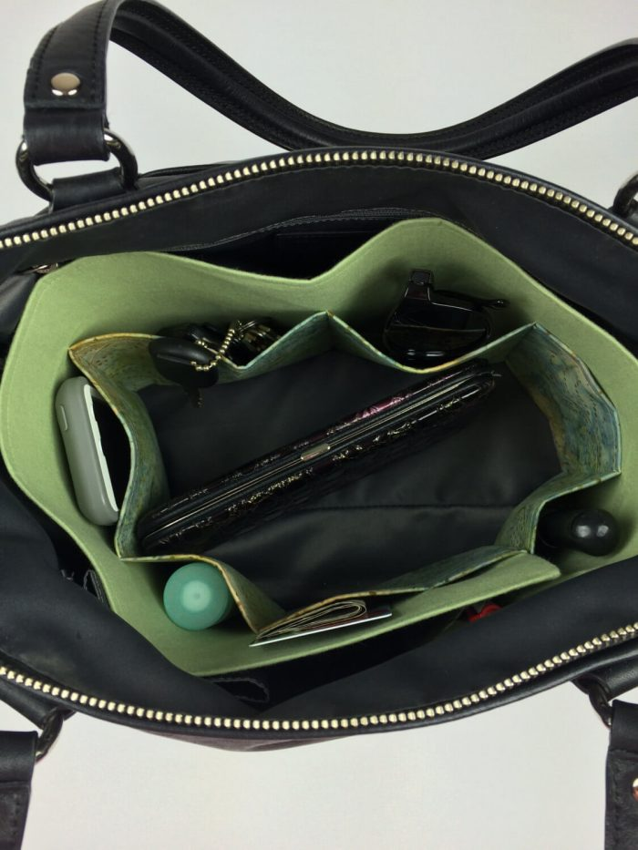 This Handbag Organizer from In A Gift Box will help tame the clutter in your purse.