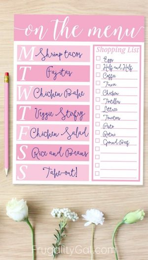 free printable meal planner with pink highlights on a wooden desk