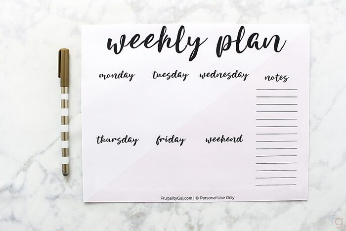 Example of the free full sized weekly planner page with the days of the week and notes.  It also includes a gold pen on a marble background.