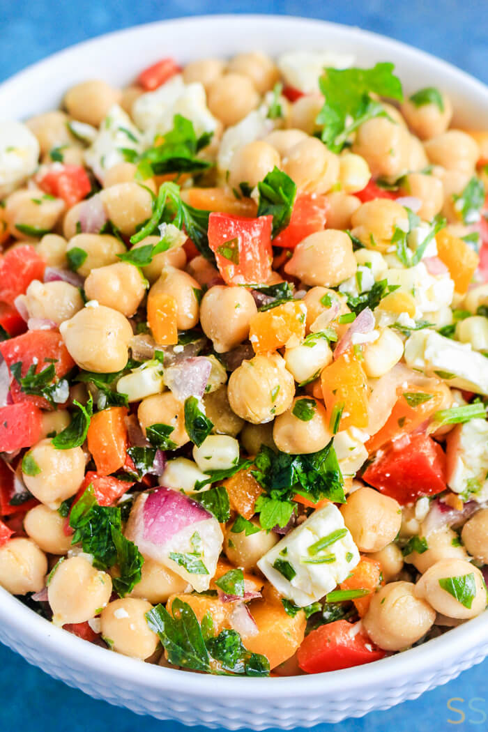 closeup picture of Mediterranean Chickpea Salad with a light dressing.