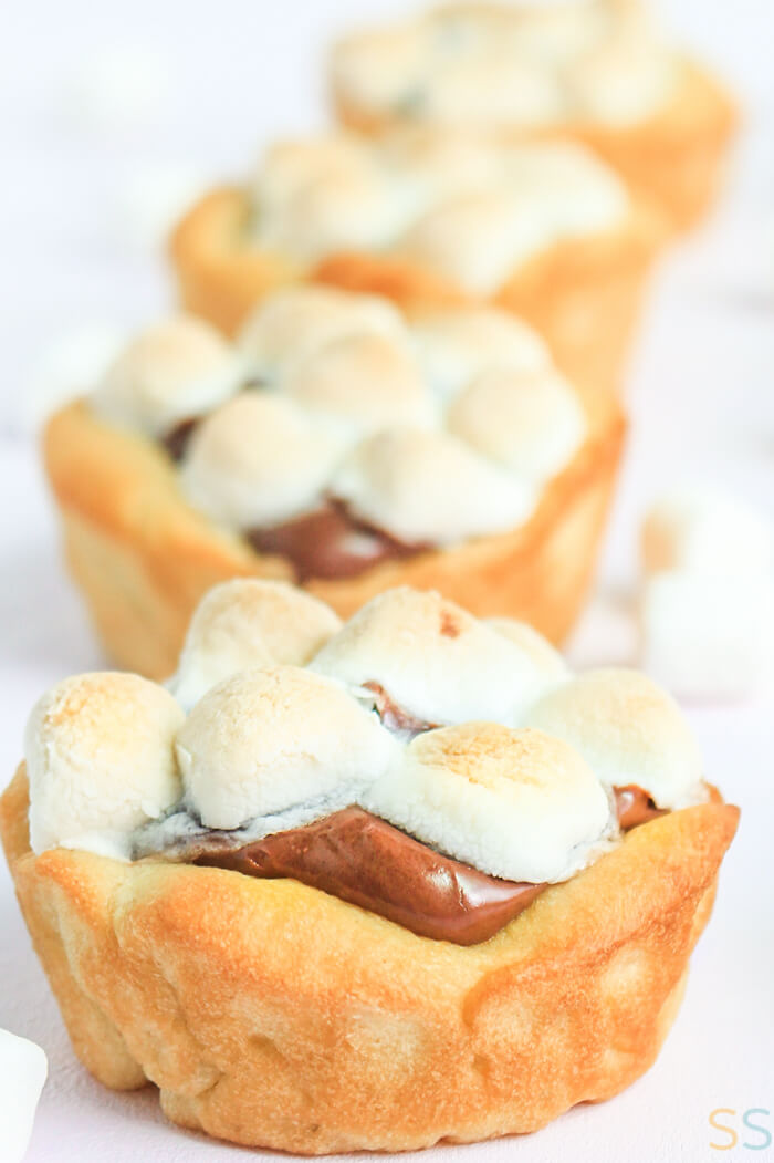 Toasted s'mores cup with Nutella peeking out from under the toasted marshallows.