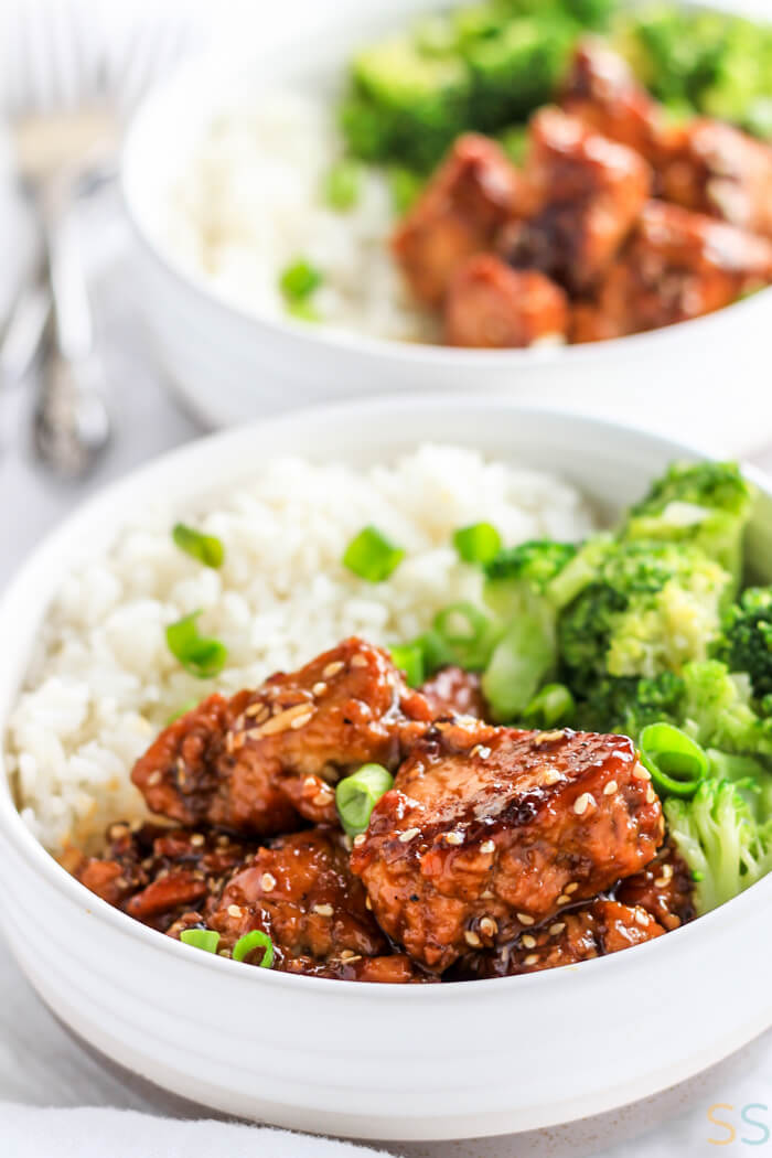 Rice, broccoli and the teriyaki tofu in a white serving bowl.