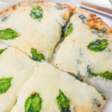This Spinach Alfredo Pizza is creamy, gooey and cheesy and best of all, this easy recipe is ready in under 20 minutes.