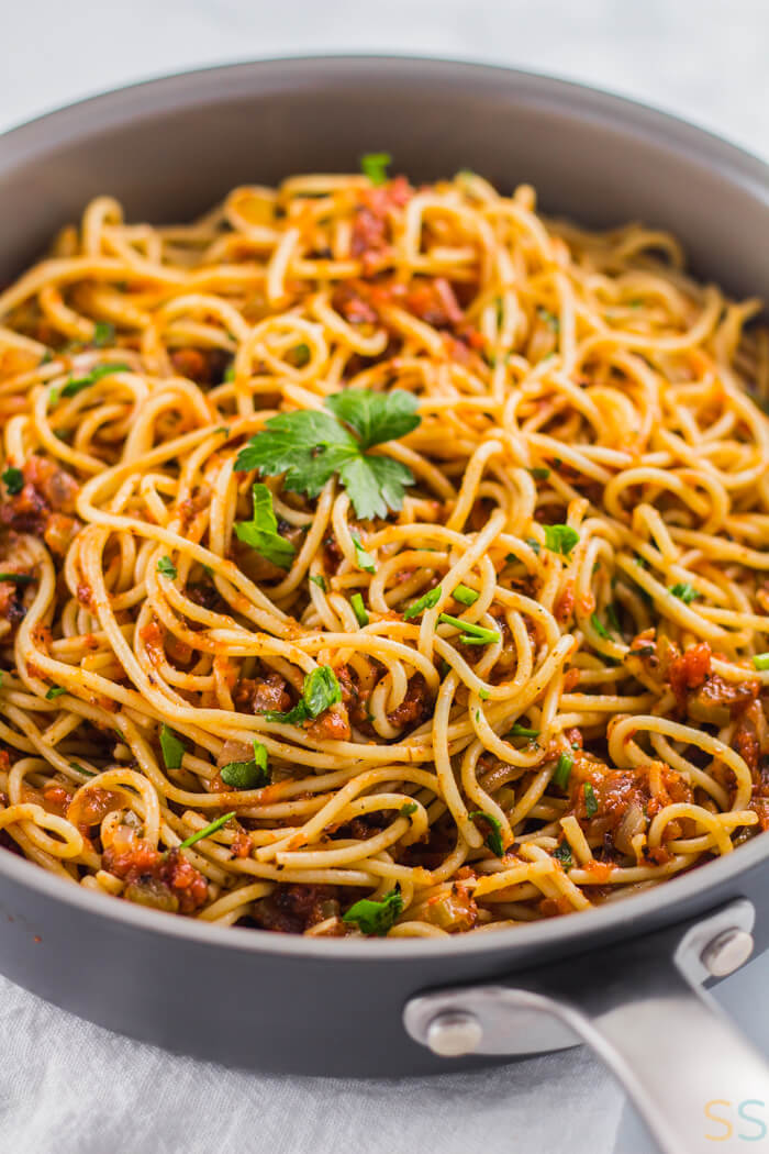 Vegan Spaghetti Sauce over pasta and sprinkled with flat leaf parsley.