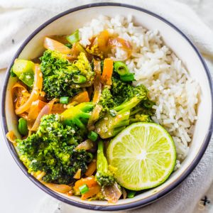 Bowl of Broccoli Stir Fry with a fresh lime