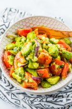 bowl of avocados and tomatoes chopped up for a delicious low carb healthy side dish