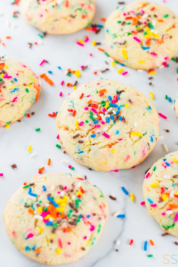 several funfetti cake mix cookies on a marble background
