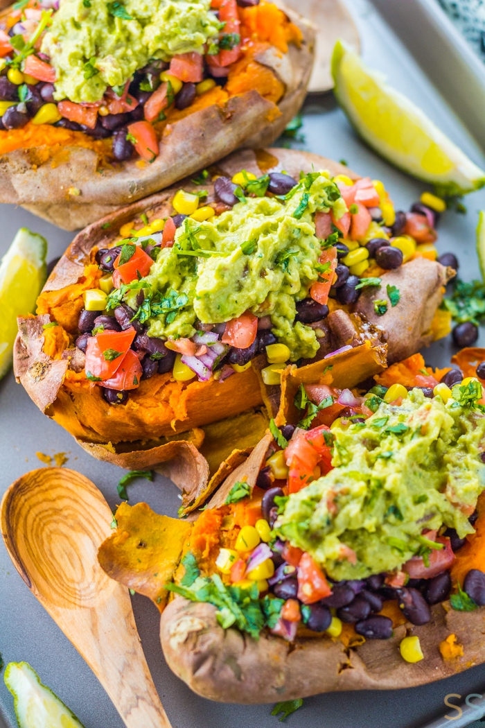 Make these Vegan Black Bean Taco Stuffed Sweet Potatoes for a satisfying Mexican dish that's healthy, fresh and amazingly flavorful.