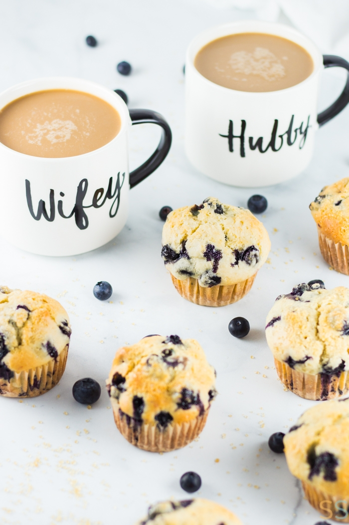 Blueberry Muffins in front of two cups of coffee.