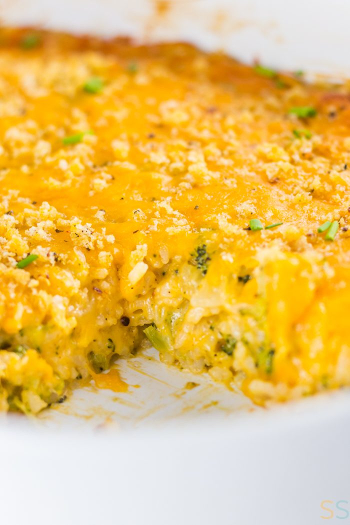 Cheesy dish with broccoli and rice in a large 9x13 baking dish.