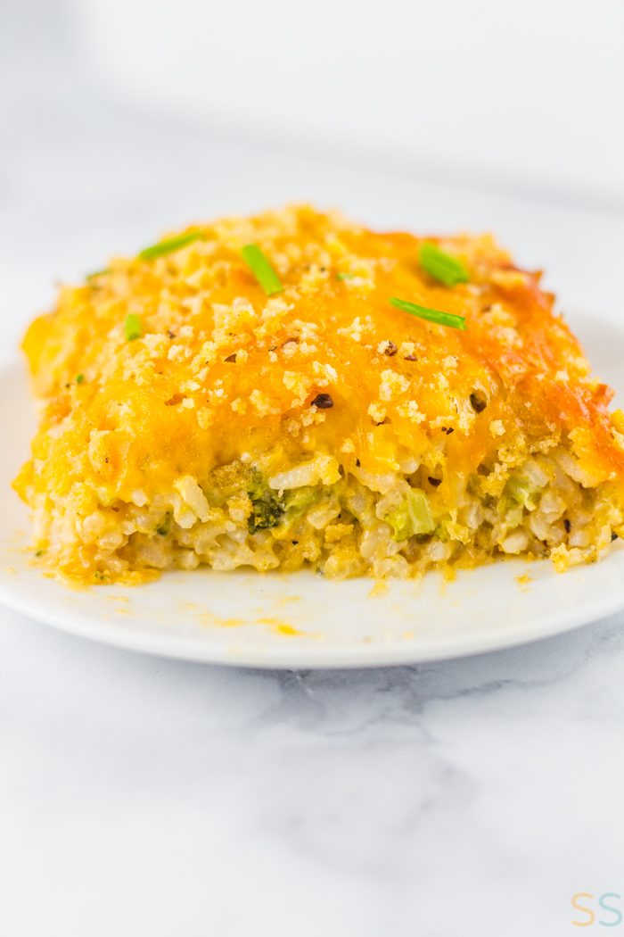 This cheesy broccoli rice casserole is the ultimate in comfort food. It comes together quickly and this single piece of the casserole will fill you up as a great dinner!