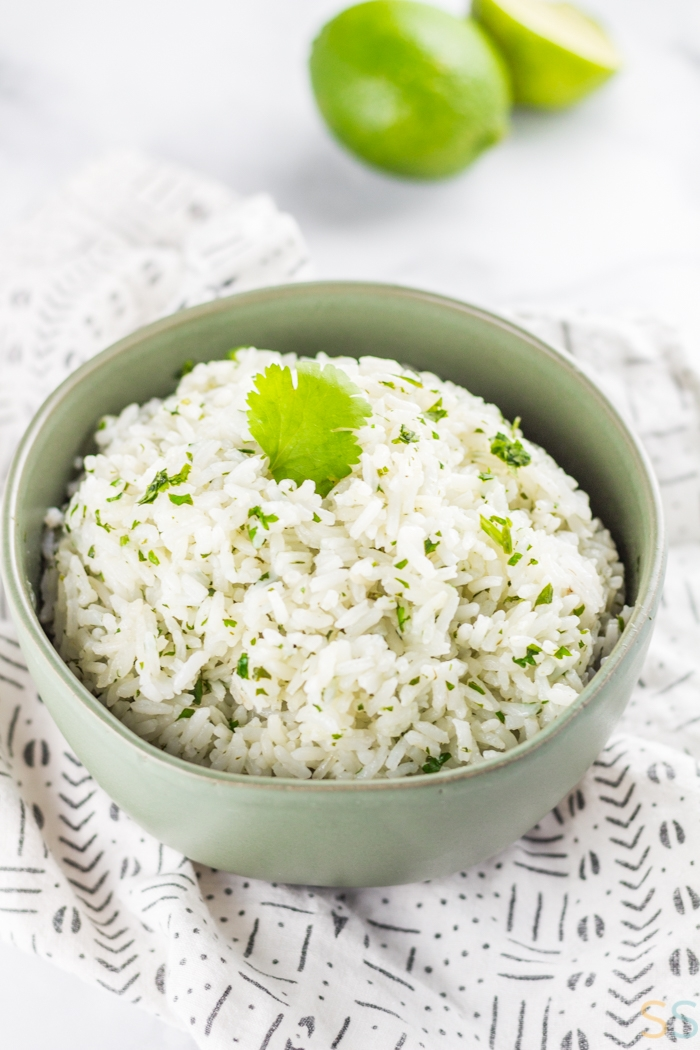 This easy cilantro lime rice recipe will feed your chipotle cravings, without having to leave home! This easy side dish is the perfect addition to a homemade burrito bowl or any other simple meal requiring an extra kick of flavor.