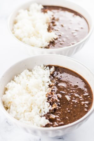 Slow Cooker Black Bean Soup with Rice in a white bowl