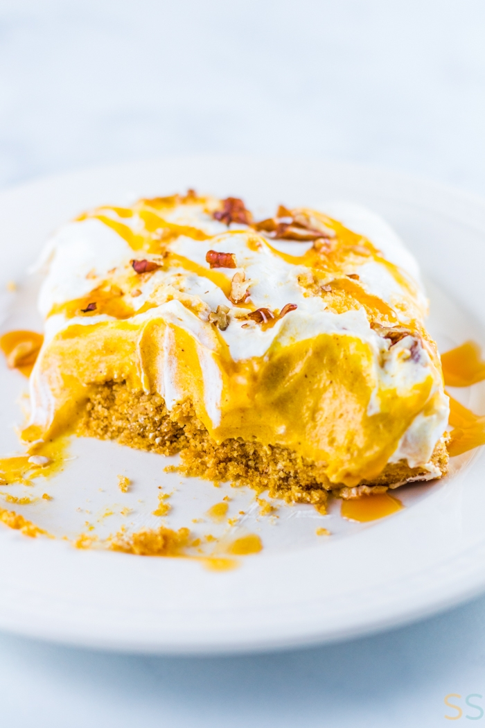 This pumpkin delight dessert recipe is an easy fall baking recipe to get in the fall spirit! This indulgent layered pumpkin dessert is sometimes also called a pumpkin lush dessert or a pumpkin lasagna dessert. It's an easy almost-no-bake dessert (just the crust is baked) that is super easy to make for a crowd!