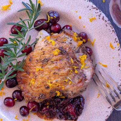 Plated Cranberry Chicken Thigh with Rosemary and Fresh Orange Zest