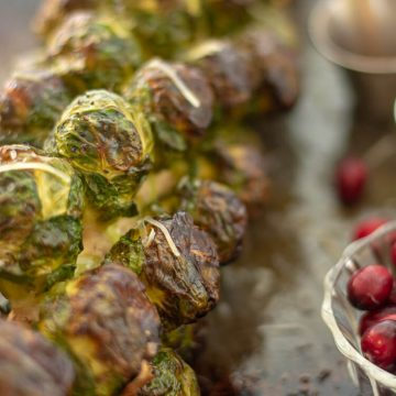 Parmesan Sprinkled on the Roast Brussel Sprout Stalks Resting on the Sheet Pan