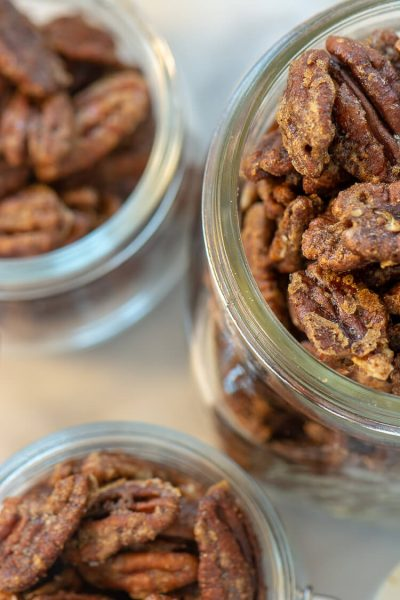 Three Decorative Jars with Spiced Pecans with a top-down view. These make a DELICIOUS gift