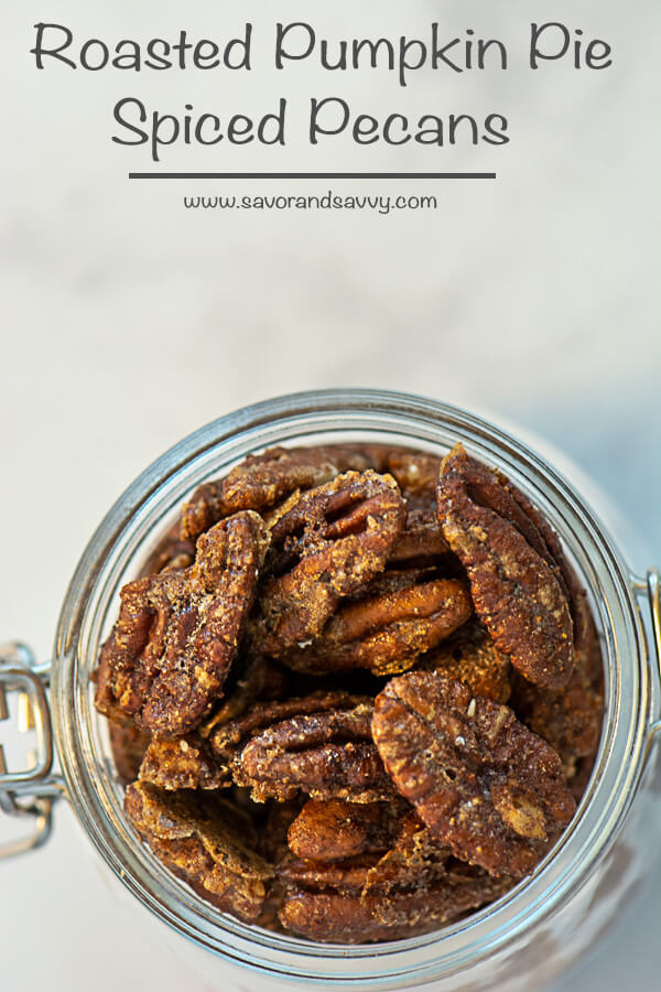 Delicious and Easy Roasted Pumpkin Pie Spiced Pecans in a Glass Jar.