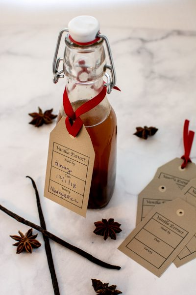 Bottle with Stopper Filled with Vanilla Extract and a Beautiful Printable Tag to Record the Date Made and Bean Variety