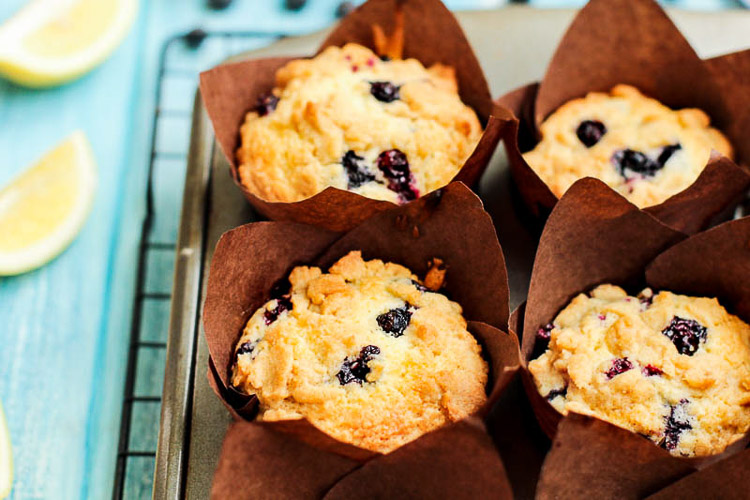 Muffin Liners Wrapped around the Blueberry Lemon Streusel Muffins