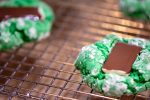 Green Mint Cookie on a cooling rack with the chocolate melting