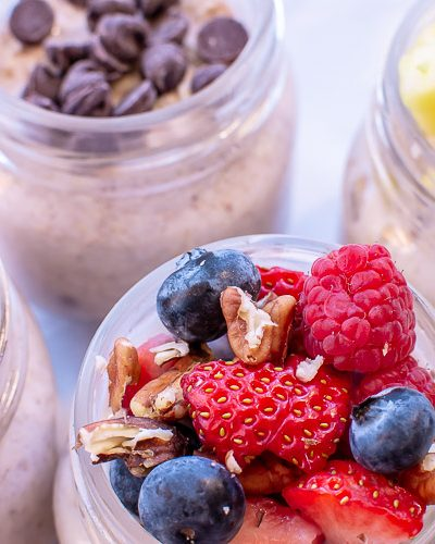 Top down image of four overnight oats recipes including Triple Berry, Banana Nut, Tropical, and Chocolate Chip