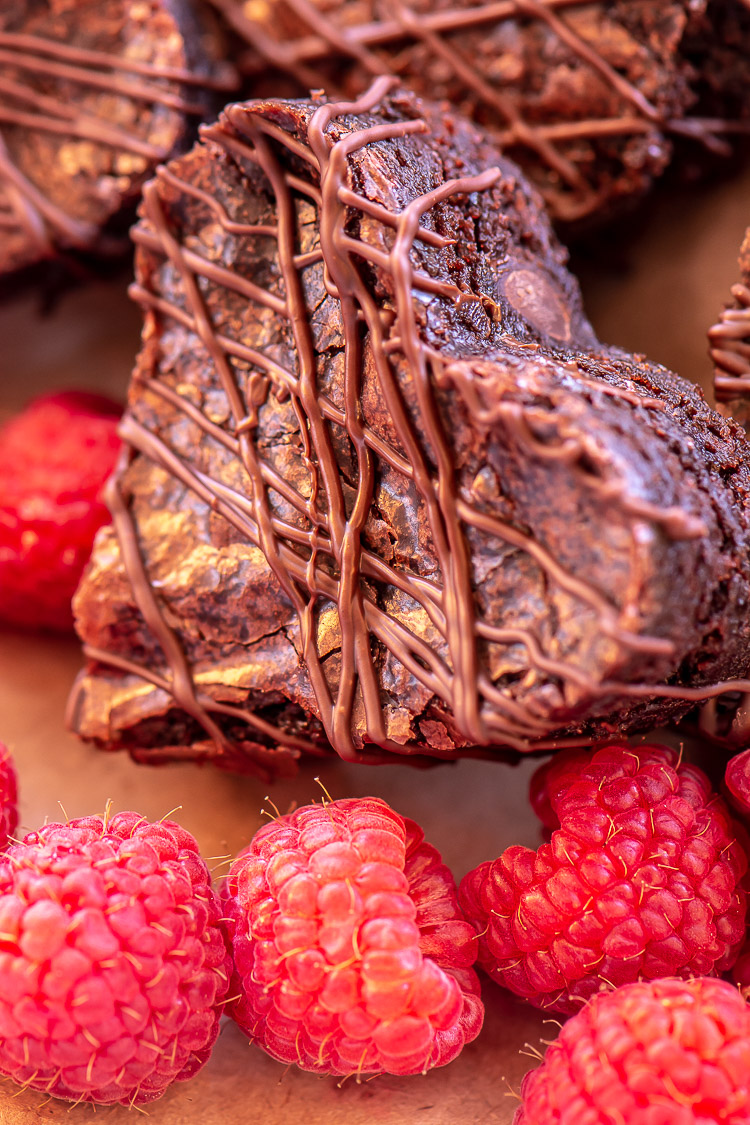 Heart Shaped Brownie and Bright Red Raspberries Drizzled in Melted Chocolate