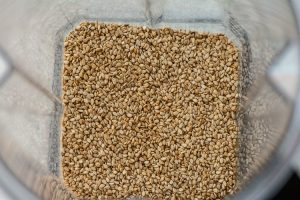 Top down shot of the freshly toasted sesame seeds in the Vitamix ready to be turned into tahini