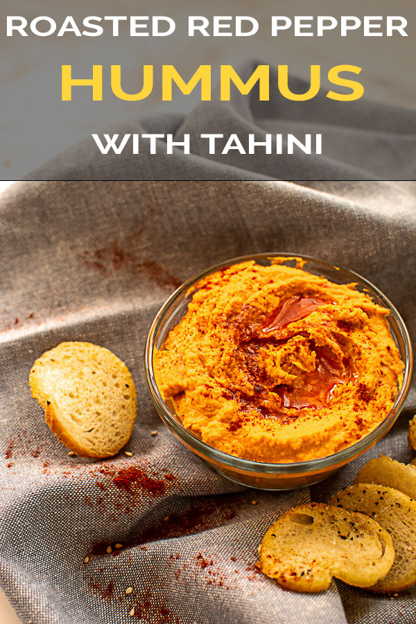 Homemade Roasted Red Pepper Hummus with Tahini. Learn the easy steps to making this delicious vegan snack at home. #hummus #tahini #vegan #vegetarian #healthysnack