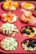 Black Olives and Cheese Top these Ham and Egg Cups