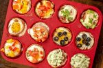 Top Down View of the Red Silicone Muffin Tin Tray with Eggs Topped With Vegetables