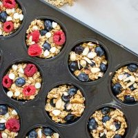 Top down view of the two different flavors of Baked Oat Cups ready to go into the oven