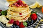 Close up of light and Fluffy Raspberry Lemon Ricotta Pancakes