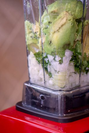 Add the avocado and ingredients to the high speed blender