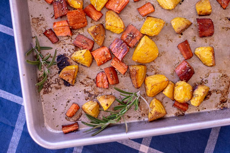 Top down view of the roasted vegetables on the sheet pan