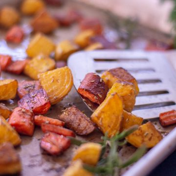 Roasted Golden Beets and Carrots on a small sheet pan tossed with Rosemary and Balsamic Vinegar