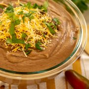 Healthy Slow Cooker Refried Beans in a Glass Bowl