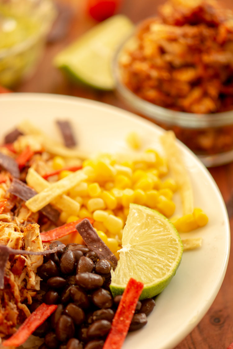 Chicken Burrito Bowl is a healthy and filling meal. Load it with fresh veggies.